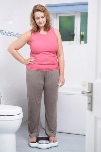 Your Sugar Land dentist discusses the important link between periodontal disease and obesity.